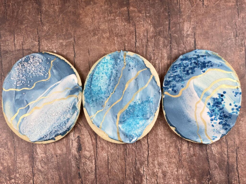 Different sanding sugar colors on blue apatite cookies