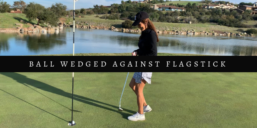 ball-wedged-against-flagstick