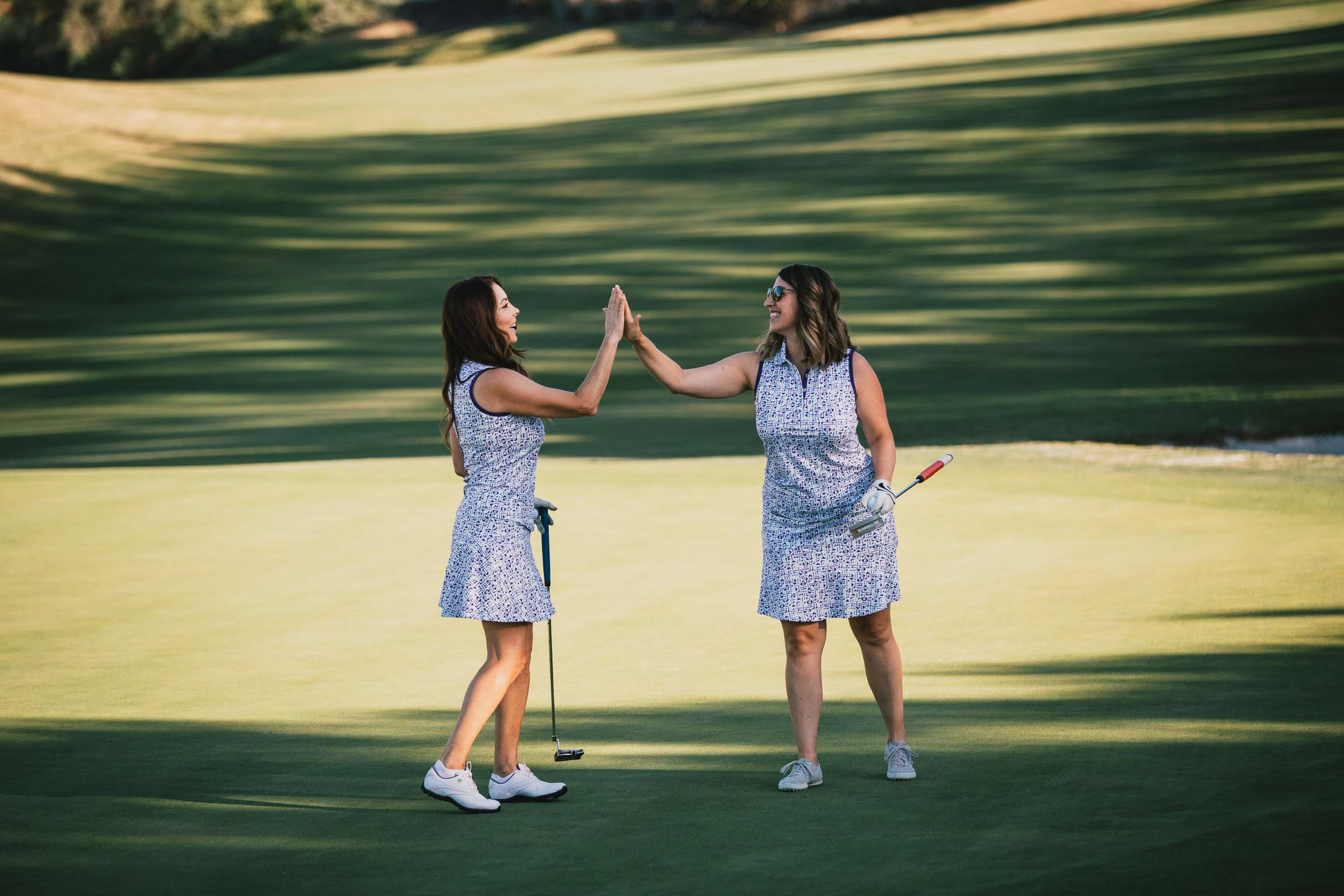 Marcela High Five on the Golf Course