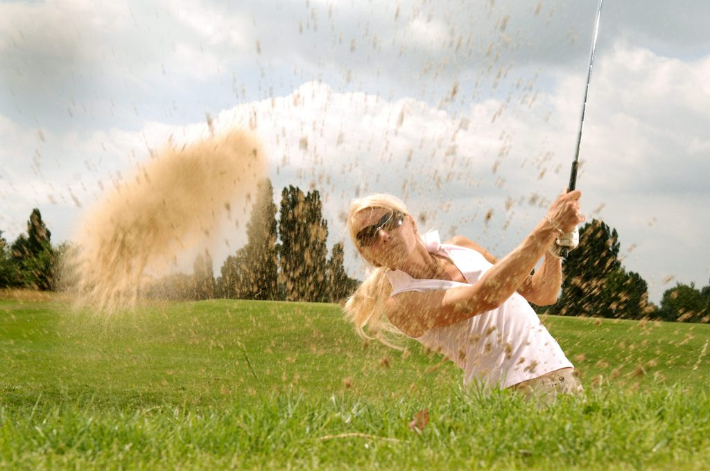 Woman-Playing-Golf-During-Daytime