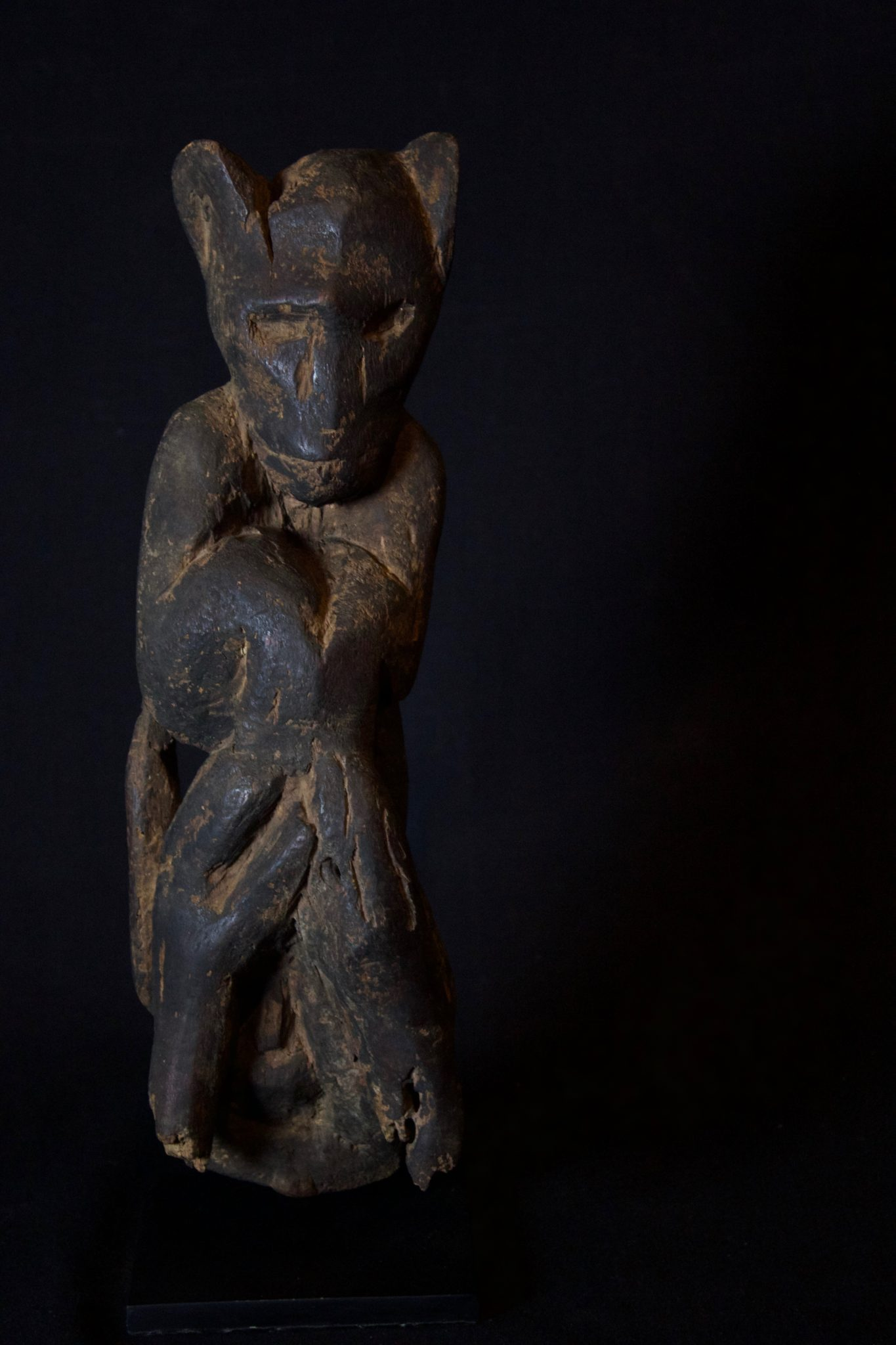 "Shaman Protection Figure, Kalimantan, Borneo, Indonesia, Modong Dayak tribe, Late 19th c, Wood darkened with soot. Shaman use these to protect themselves and villagers from evil creatures, 14"" x 4 ¼"" x 4"", $560"