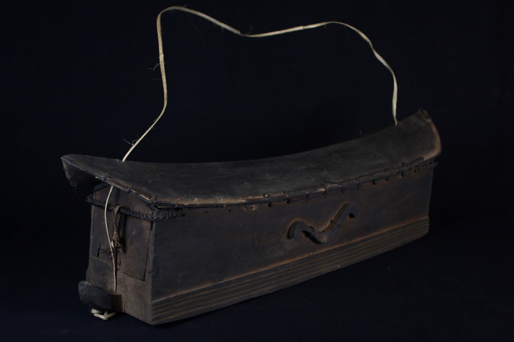 "'Salipa', Medicine Boat Box, Mentawai Islands, Sumatra, Indonesia, Mentawai tribe, Early 20th c, Wood with reed stitching and strap. Used by shaman to store implements to be used when called upon to convene with spirit world. 8"" x 26"" x 5 ¾"", $1100."