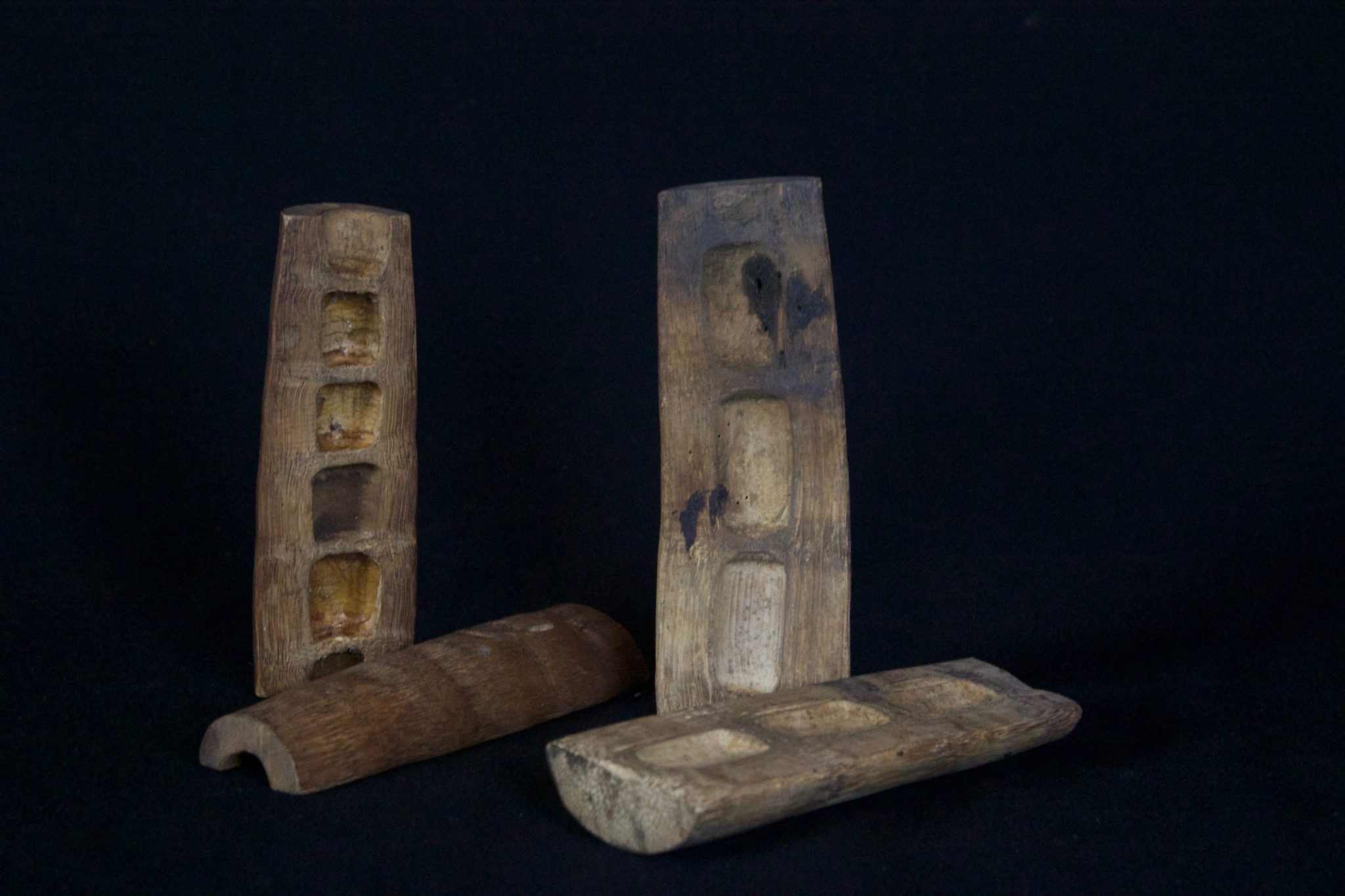 """Yin Yang Divination Blocks, Vietnam, Early 20th c, Bamboo, These pairs of blocks are used by shaman to get answers to questions and requests. They are round on the yin side and flat on the yang side. They are thrown like dice. The answer is determined by the configuration of how they land: 1 yin and 1 yang side up = YES; Both the same side up = NO (also typically made of wood or horn) $175 each set. Dimensions: (right - 5"""" x 1 ¾"""" x 1 ½""""); (left - 4 ¾"""" x 1 ½"""" x 1 ½"""")"""