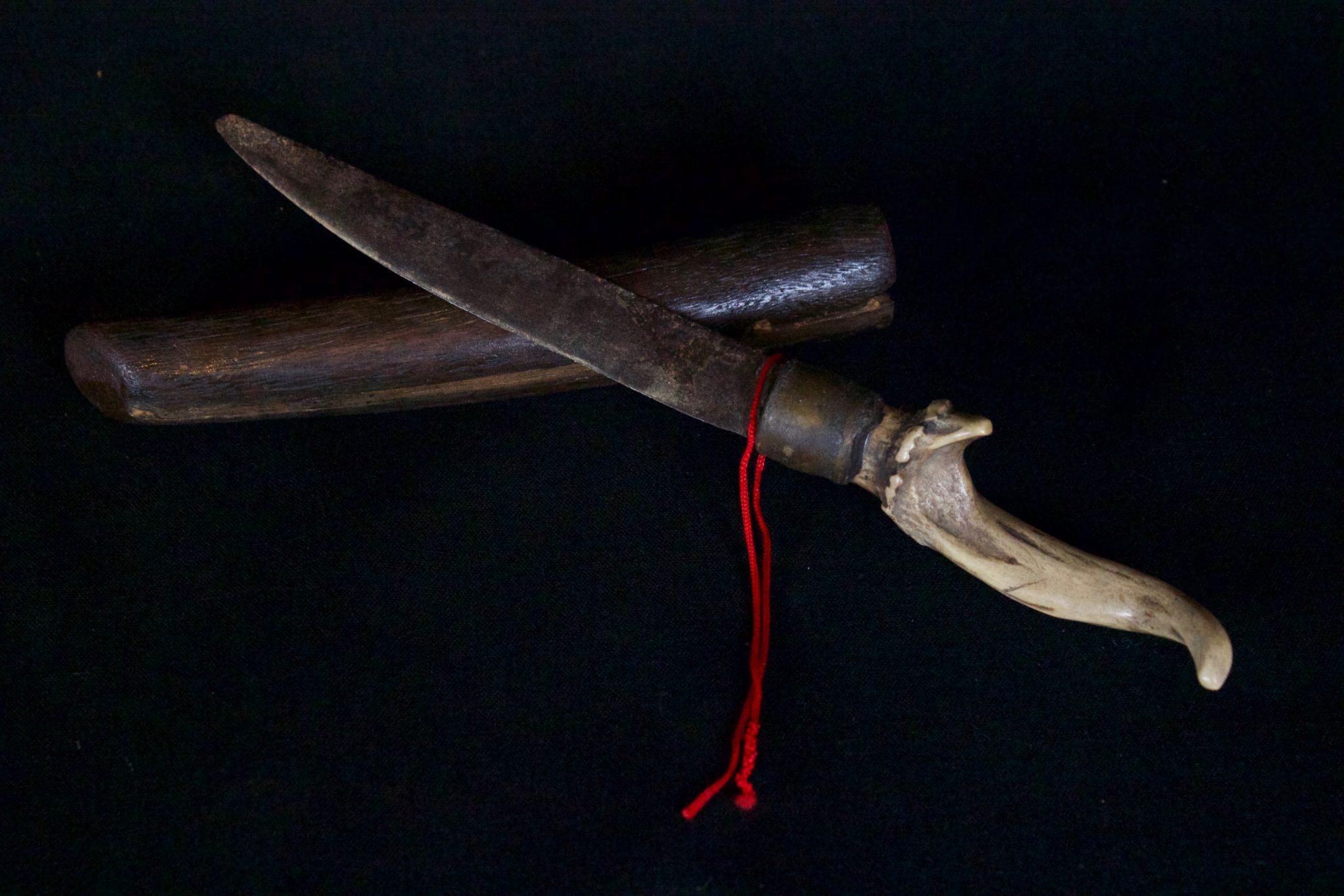 "Shaman's Personal Knife and Sheath, Vietnam, Yao people Late 19th c, Metal, horn, wood, 10"" x 1 ½"" x 1"", $580."