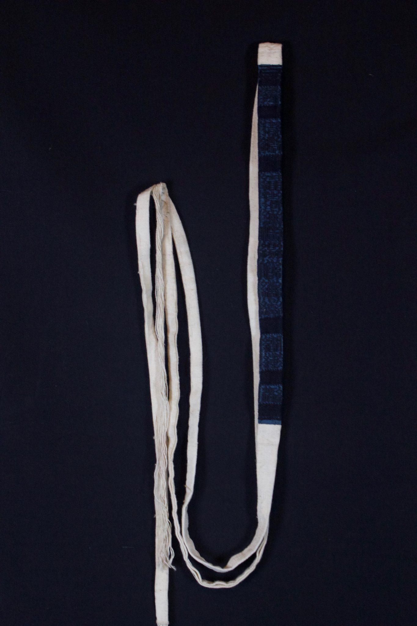 "Shaman Belt, Vietnam, Yao people, Mid 20th c, Cotton cloth, indigo dye, Part of shaman's costume. 110"" x ¾"""" x ⅛"", $30"