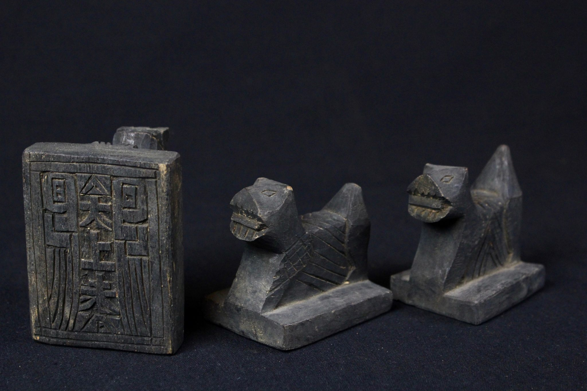 """Shaman's Stamp 'Chop', Northern Thailand, Mid to late 20th c, Wood, pigment, Important tool for a shaman. They are unique to a particular shaman and used as a mark of authenticity. They would be placed on a message from one shaman to another, to the deities or into the shaman's book. $50./$60. each, Dimensions left to right: (left -2 ¾"""" x 2 ¼"""" x 3 ½"""", $60.); (middle - 2 ¾"""" x 2"""" x 2 ¾"""", $50.); (right - 2 ¾"""" x 1 ¾"""" x 2 ¾"""", $50.)"""