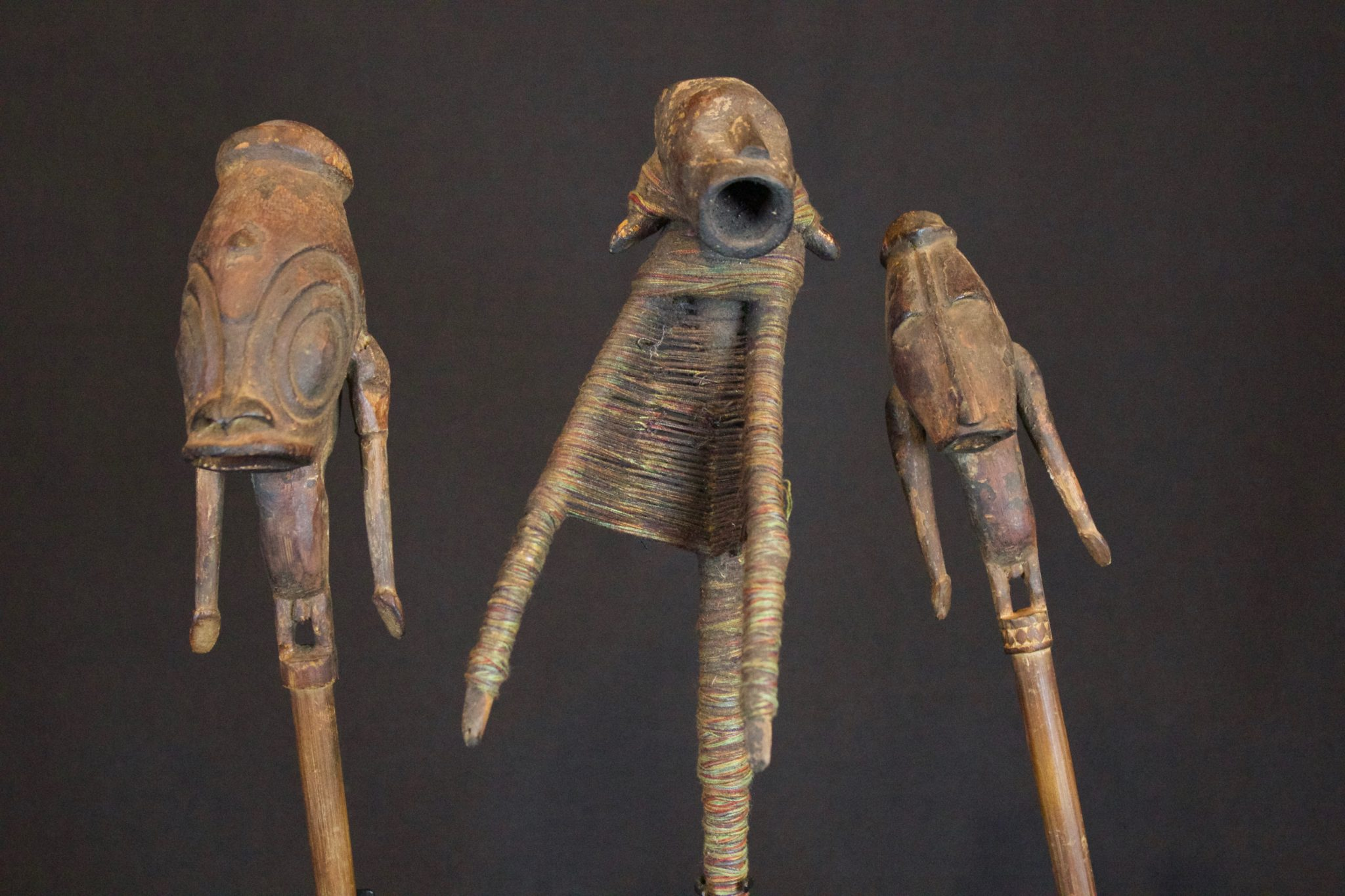"Shaman Talisman Figure, Papúa New Guinea, Indonesia, Early 20th c, Wood. Used in ritual ceremonies to stop rain. (Figure on right - 12 ½"" x 2"" x 2 ½"", Sold)"