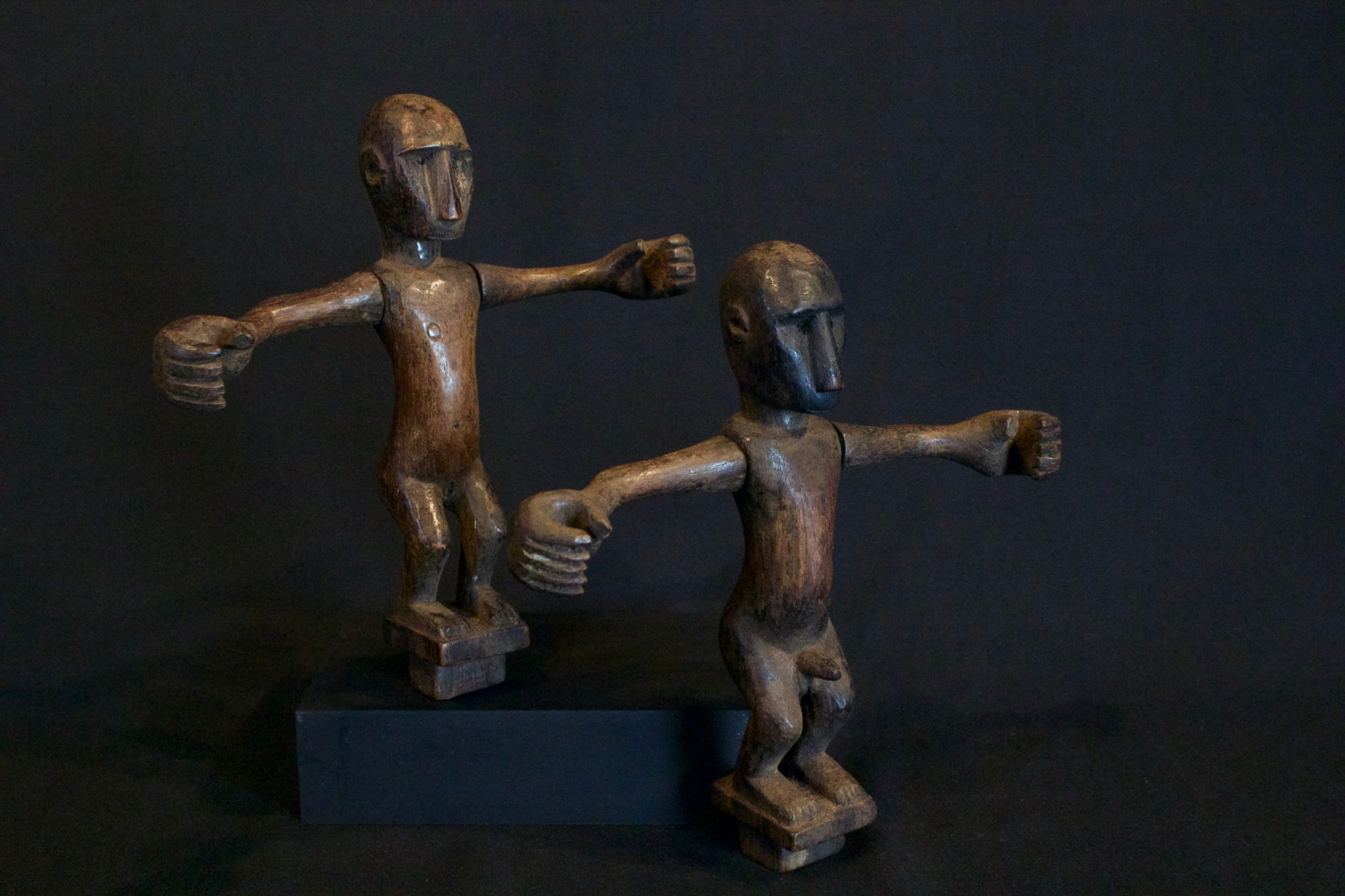 "Shaman Healing Figures, Male and Female Couple, Flores Island, Lesser Sunda Islands, Mid 20th c. Wood, patinated with use and age. One of the pair held in each hand during a ceremonial dance for healing a marriage. (female - 8"" x 7 ¾"" x 1""); (male - 8"" x 8"" x 1 ½""), $590 (sold as pair)"