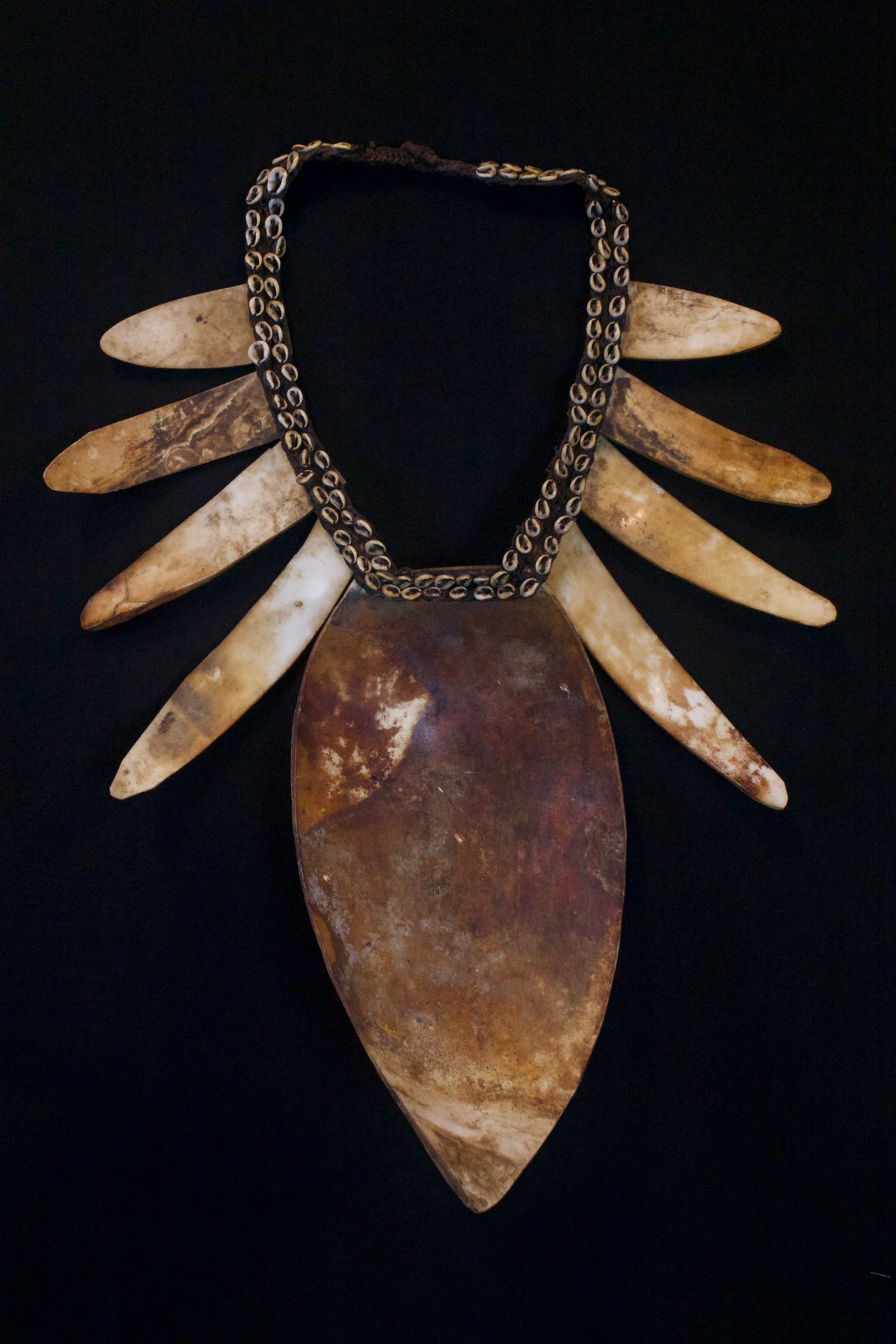 "Shaman Shell Necklace, Papua New Guinea (Irian Jaya), Indonesia, Mid 20th c. Shell, cloth, fiber cord. Worn by the shaman for healing ceremonies. 19"" x 15"" x 3 ½"" $850."