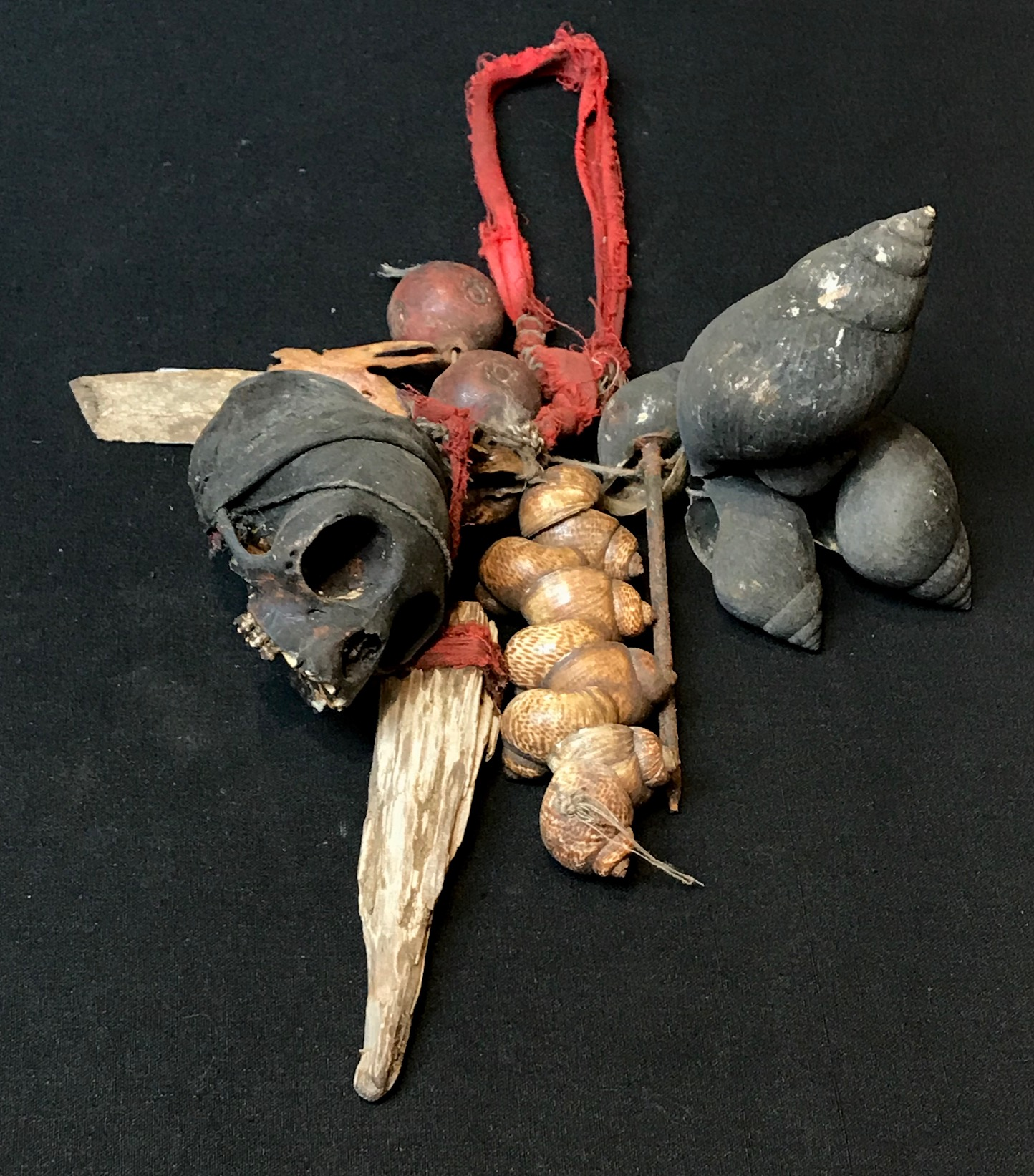 "Shaman's ritual dance rattle, Indonesia, Borneo, Dayak tribe, early 20th c., Monkey skull, sea shells, metal nail, ceramic beads, glass bead, Shaken to scare away evil or harmful spirits, 12"" x 7"""