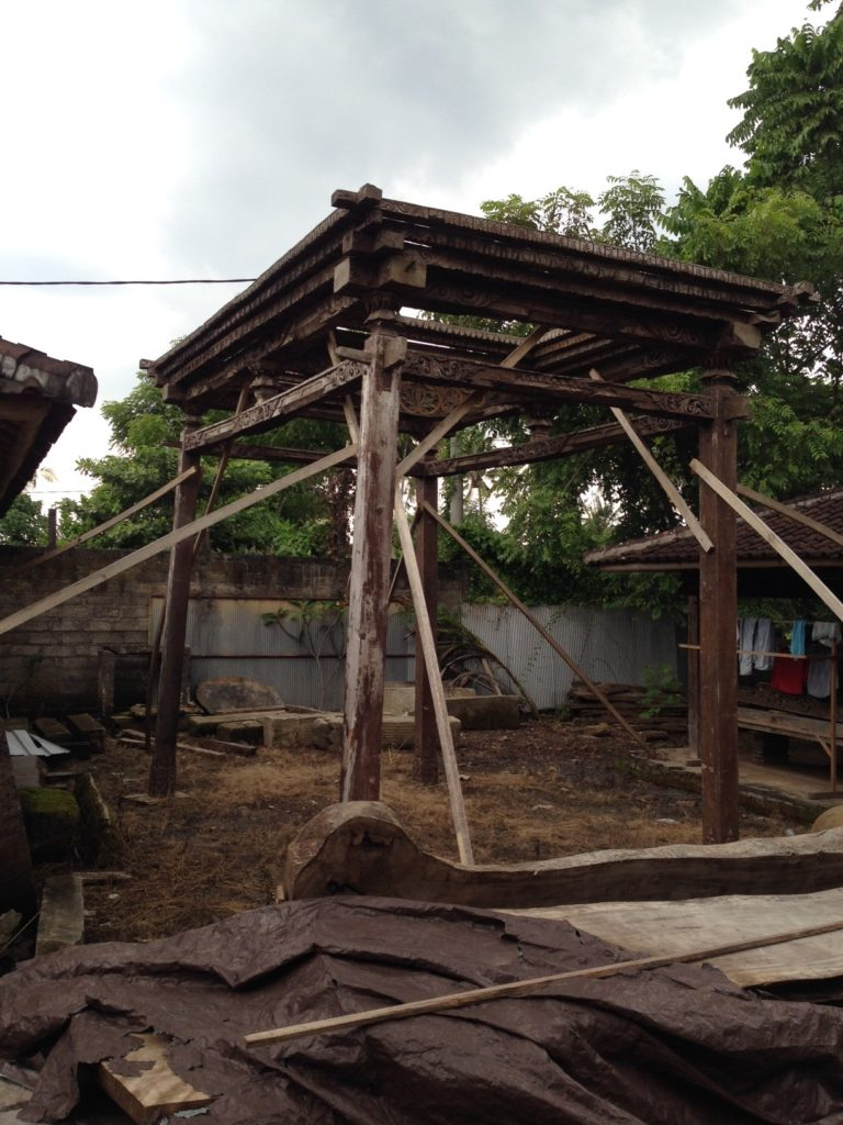 'Joglo' is the architectural vernacular for Javanese structures. Built to last, they are made of teak wood, which is beautiful as well as an enduring outdoor material. They are constructed without nails or screws using a variety of joinery techniques including 'Mortise and Tenon', 'Half-Lap' and 'Tongue and Groove'. The four tallest columns or 'King Posts' form the central part of the house or pavilion. Consecutively shorter columns extend outward to carry the rest of the sloping roof creating a vaulted central area. It relies on this tall main structure for support rather than the bearing walls of western styles which would inhibit crucial, natural ventilation.
