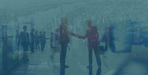 Double exposure image of two men shaking hands