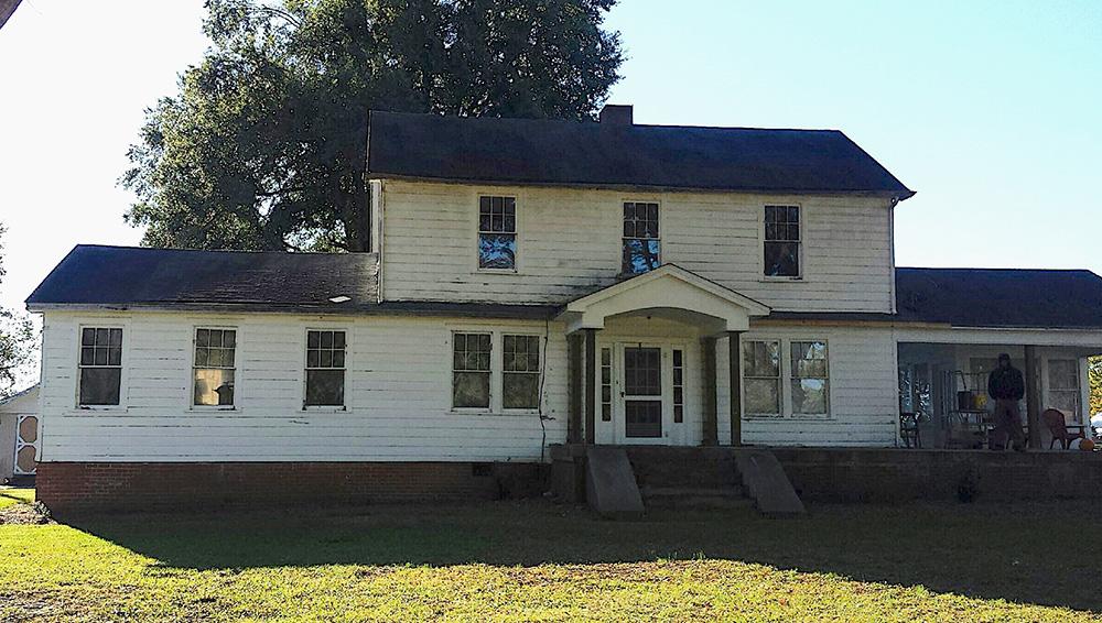 old house needing new windows and siding