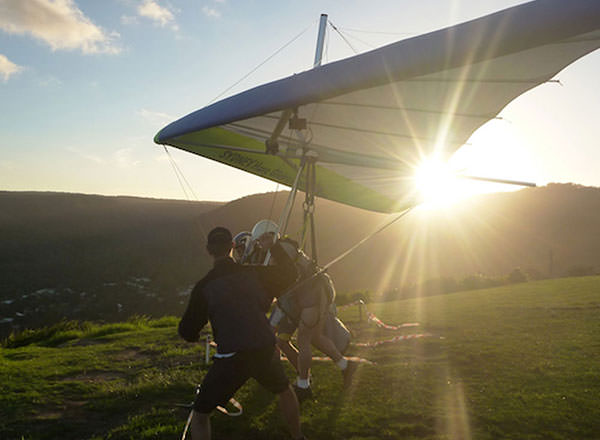 An image of handgliding on the Royal National Day Tour