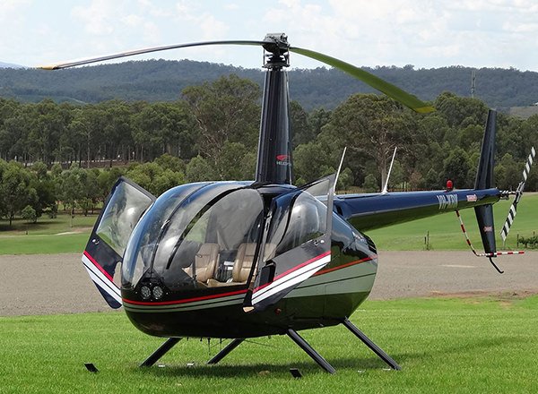 Image of helicopter about to receive passengers for a Hunter Valley Private Tour