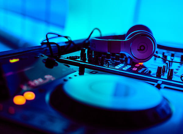 An image of a DJ's decks on-board your private yacht on your Sydney Private Day Tour