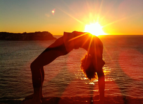 A sunrise yoga session before youron your Sydney Private Day Tour starts
