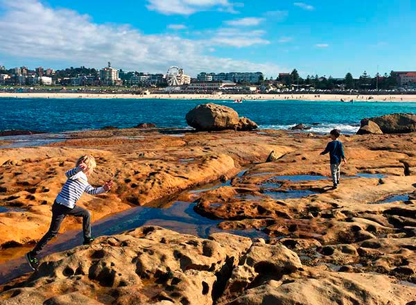 An image of rock hopping at Bondi Beach on the best kids tour in Sydney