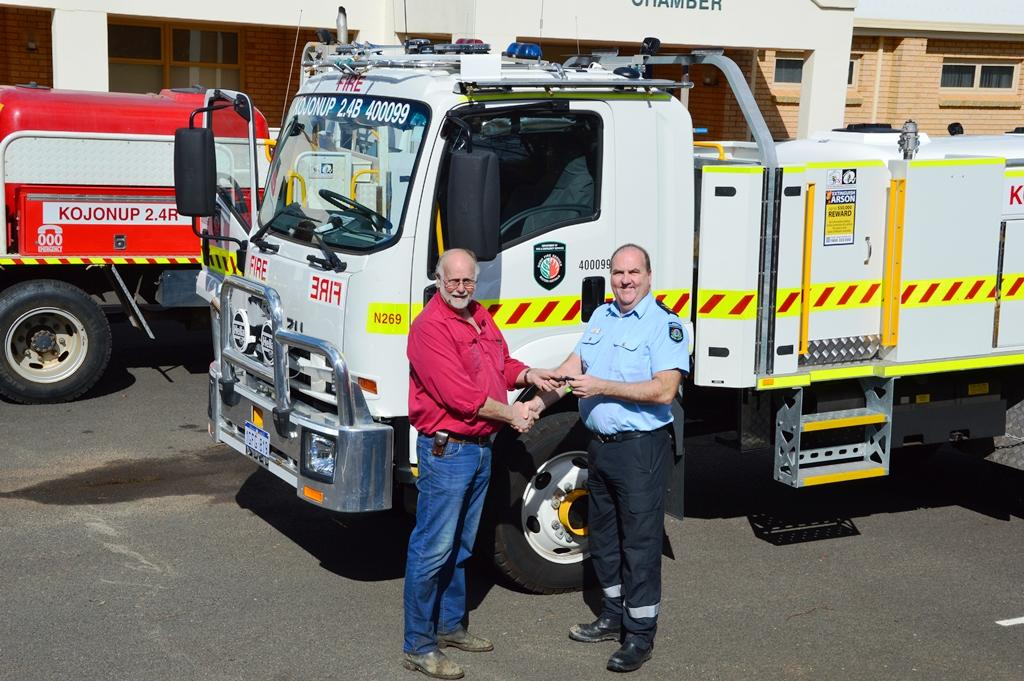 DFES area officer for Albany Tim Wall hands over the keys to the new fire truck to former Kojonup chief bushfire control officer Tim Johnston. Picture: Shire of KojonupPicture: Shire of Kojonup