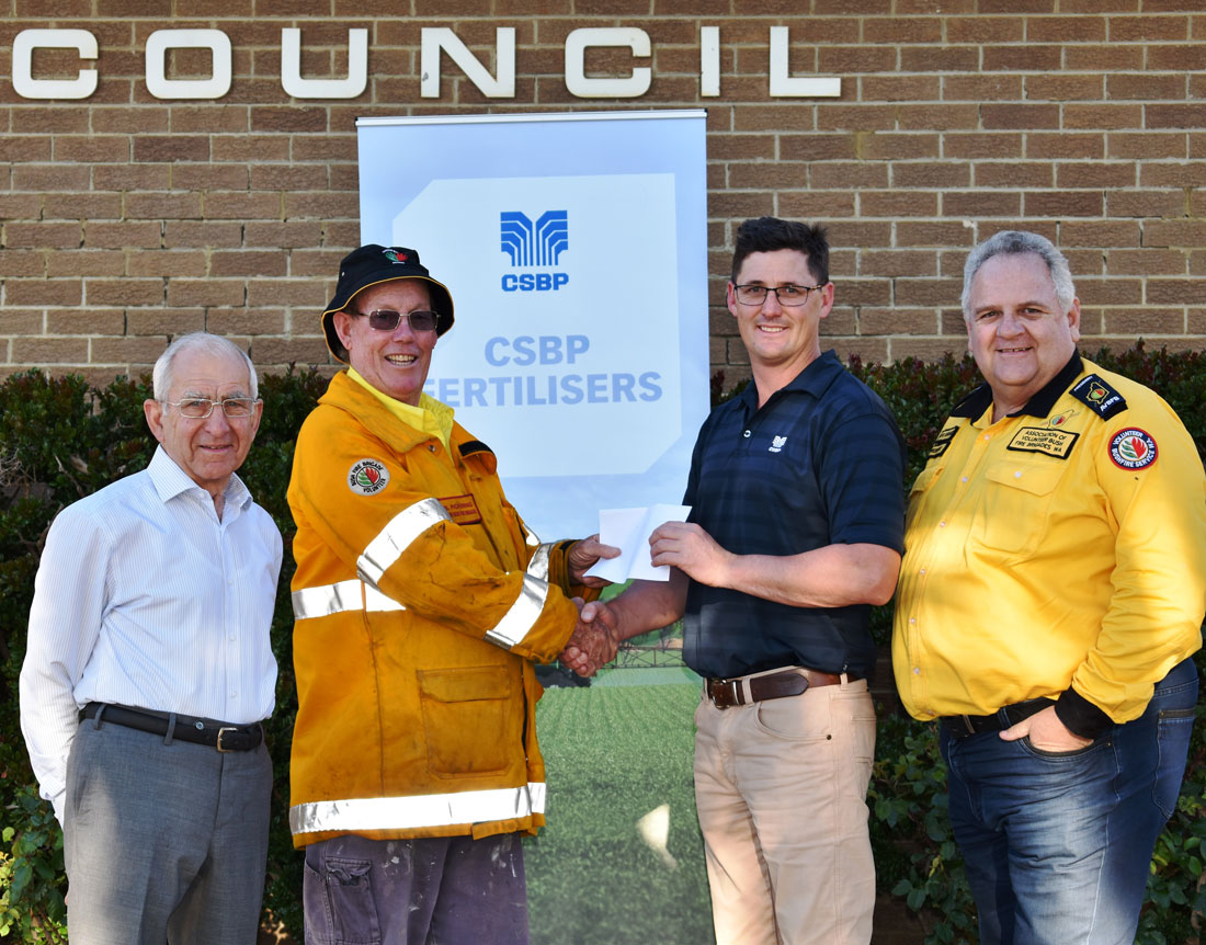 Photo of Shire of Dowerin President Cr Dale Metcalf, Chief Fire Control Officer Phil Pickering, CSBP's Matthew Williams and AVBFB President Dave Gossage AFSM in Dowerin