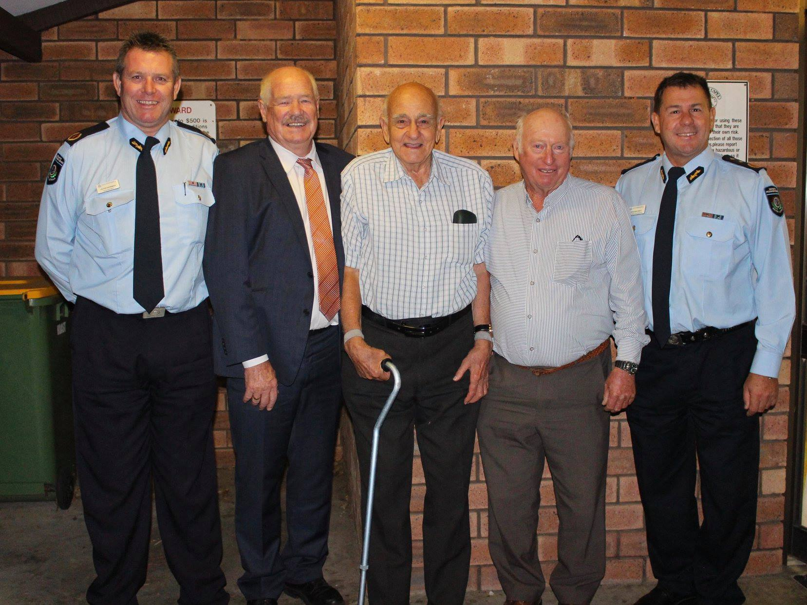 Minister for Volunteering Mick Murray and others congratulate Capel Bush Fire Brigade's John James and Elgin Bush Fire Brigade's John Prowse for 60 years of service.