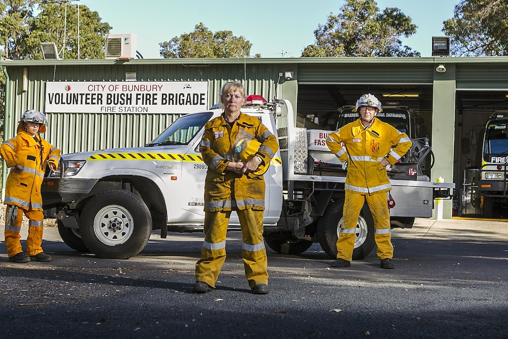 Bunbury Volunteer Bushfire Brigade captain Terri Kowal, flanked by volunteers Tilda Mason and Clive Banks, are fired up over demands for one of its vehicles to be retired.Picture: Jon Gellweiler / South Western Times