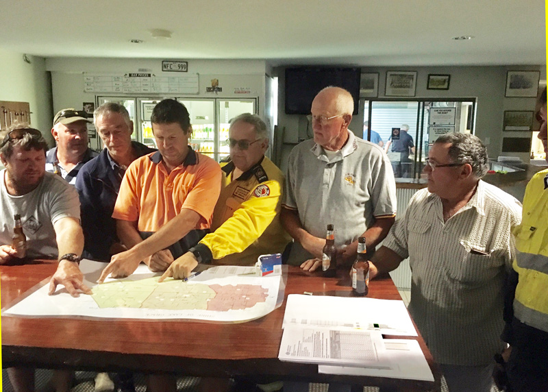 "Volunteers showing AVBFB President Dave Gossage the radio ""Black spots"" on a regional map in the Shire of Lake Grace April 2018"