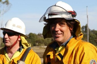 Firies Adrian Chester and Kynan McCallister arrive on the scene of a private burn on the outskirts of Albany.