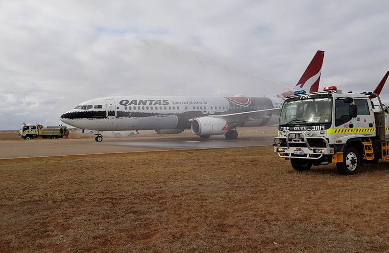 Members of City of Greater Geraldton Volunteer Bush Fire Brigades welcoming the first ever Boeing 737-800 to the City 27 May 2017
