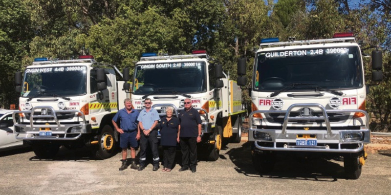 Chief Bush Fire Control Officer Phil Barrett (in uniform) with fire brigade volunteers Murray Hyne, Carolee Peace and Grahame Rivers with the brand new fire trucks. Photo: North Coast Times