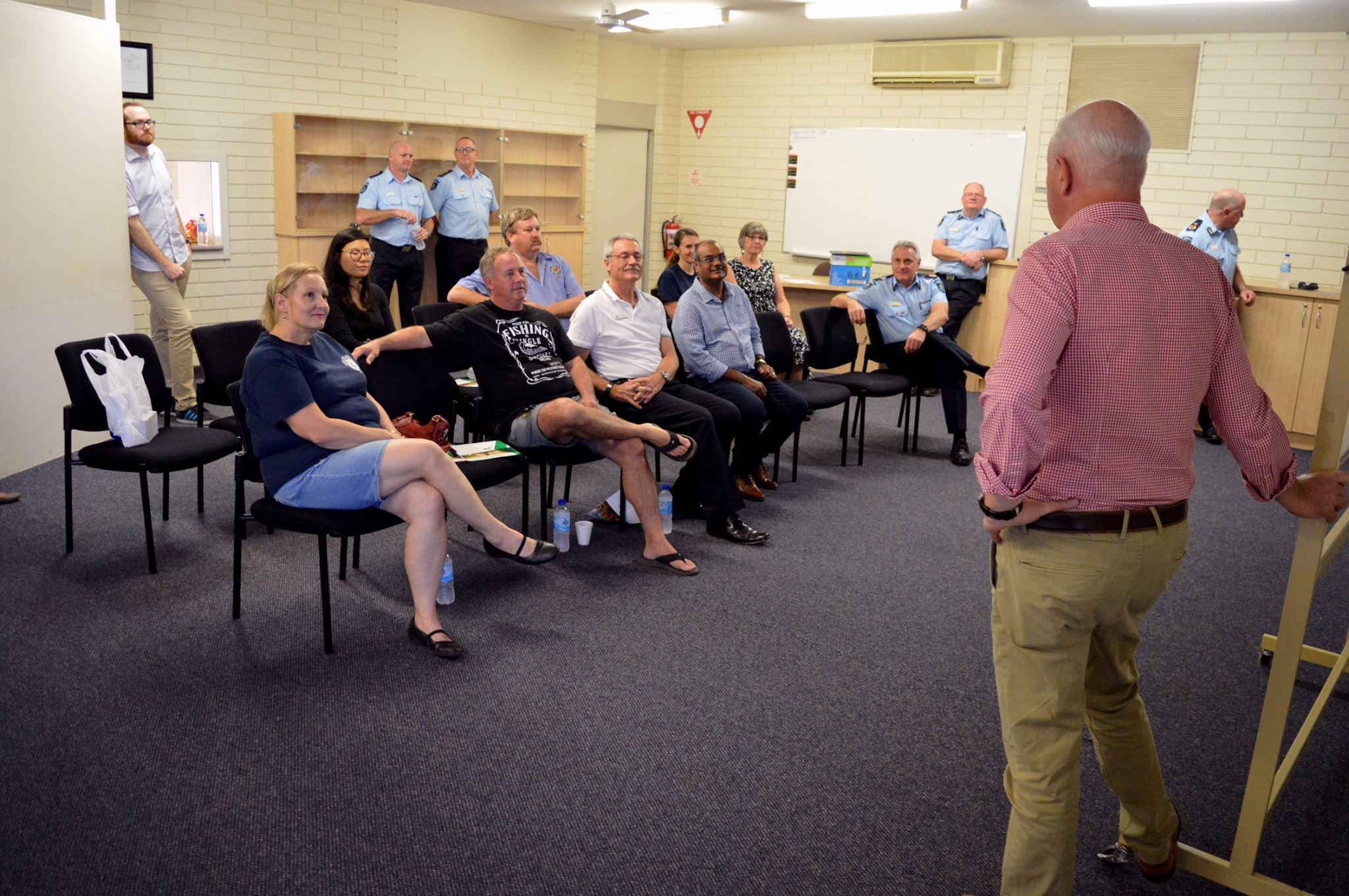 Emergency Services Minister Hon Fran Logan, FES Commissioner Darren Klemm, DFES Rural Fire Division Acting Executive Director John Tillman and other DFES and Ministerial staff explaining the Government's recent changes to emergency service volunteers in the North West. Photo: Facebook