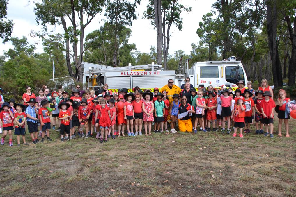 Allanson Primary School students giving a donation to the Allanson Volunteer Bush Fire Brigade in Collie Western Australia Photo: Breeanna Tirant