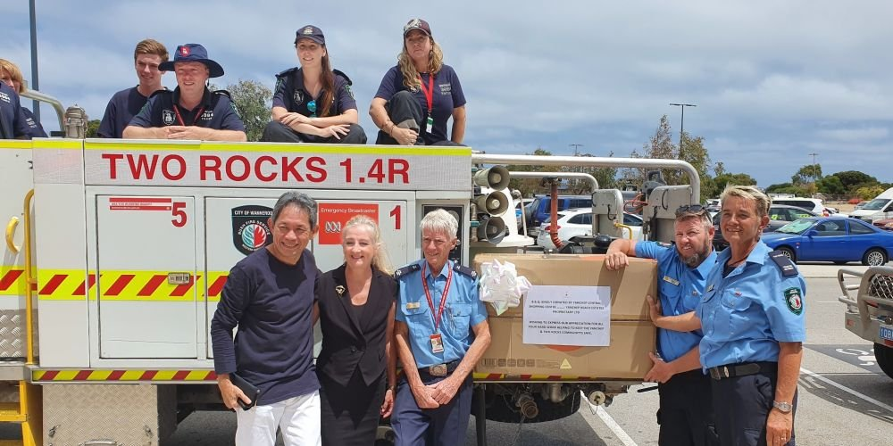 Two Rocks Volunteer Bush Fire Brigade members with Yanchep Beach Joint Venture chief executive Gin Wah Ang and Wanneroo Mayor Tracey Roberts. Pictures supplied