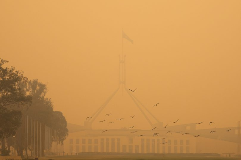Smoke blanketing Parliament House in January. Photo: Region Media.