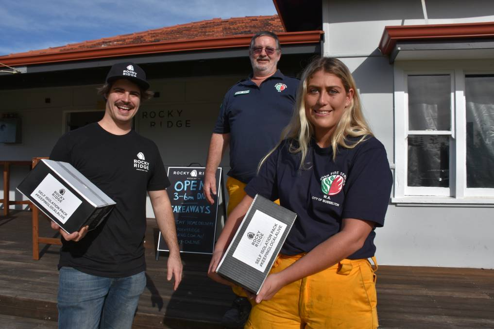Rocky Ridge cellar door manager Liam Marsh with Sussex bushfire volunteers Mark Smith and Ashleigh Charlton.