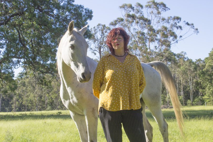Jo Dodds and her horse, Raf, at home in Tathra on the NSW South Coast. Photo: Supplied.