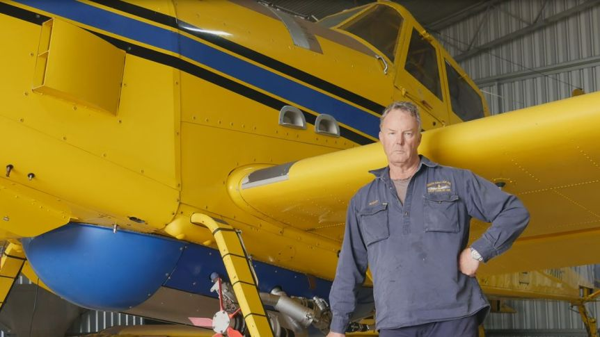Scott Mackie and his water bomber plane, which are not contracted to fly around Esperance.(ABC Esperance: Emily Smith)