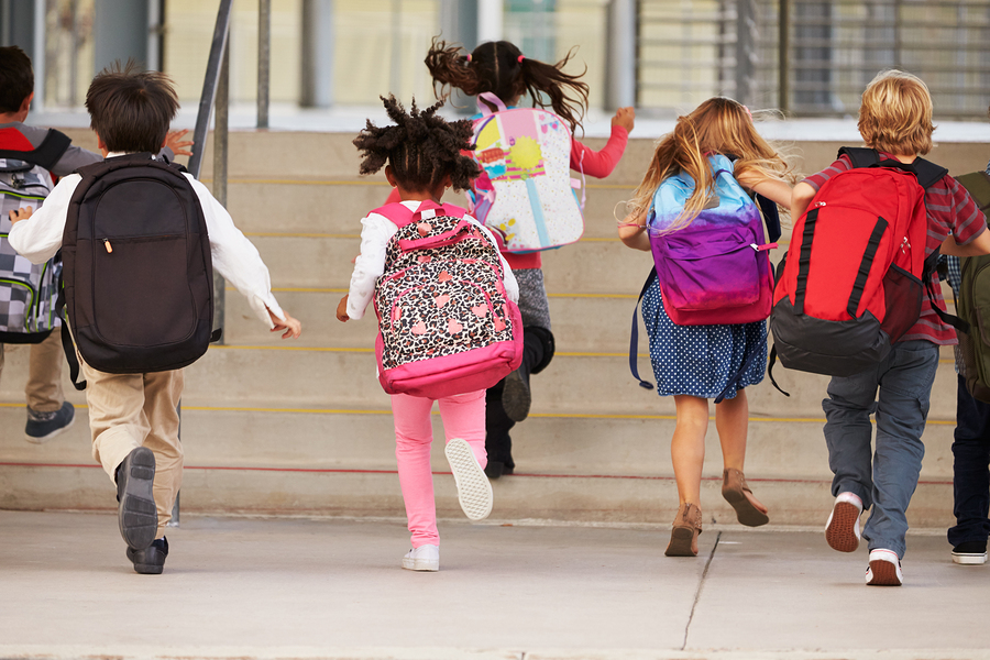 Backpack bad posture, carrying heavy backpack and health concerns in kids.