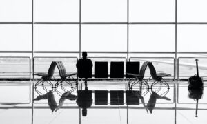 man sitting on gang chair during daytime