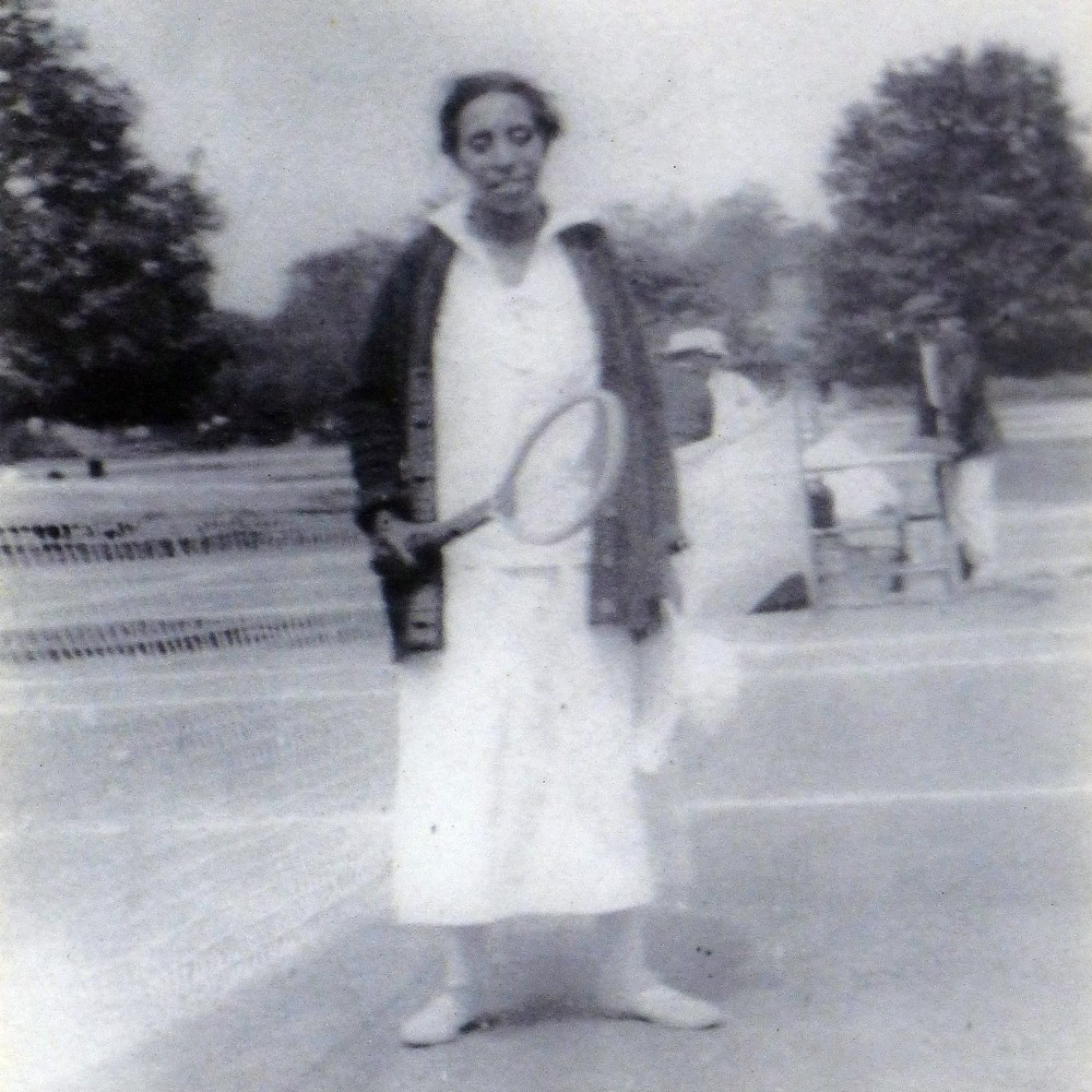 Lucy Diggs Slowe with tennis racquet