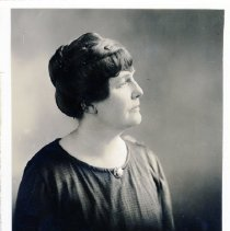 Lucy Gwynne Fisher Branham, mother of Lucy Fisher, profile photo. She has short brown hair.