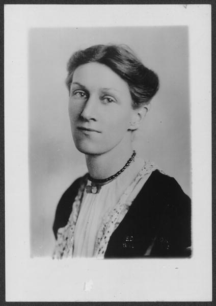 portrait of Edith Houghton Hooker. She is facing the camera with a small smile, wearing a black dress with lace collar