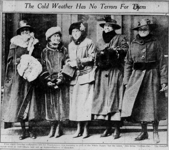 five women smiling, dressed in hats and coats