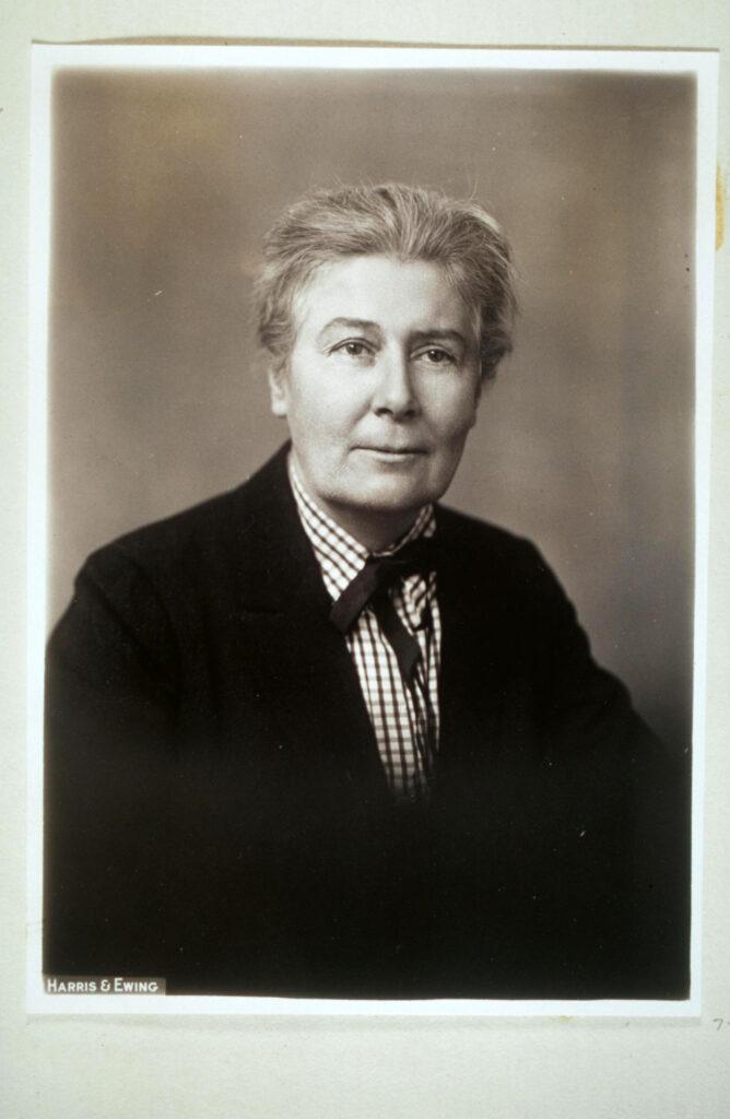 Ellen La Motte, approx 65 years old, wearing hair in bun and a dark black jacket. Formal photo