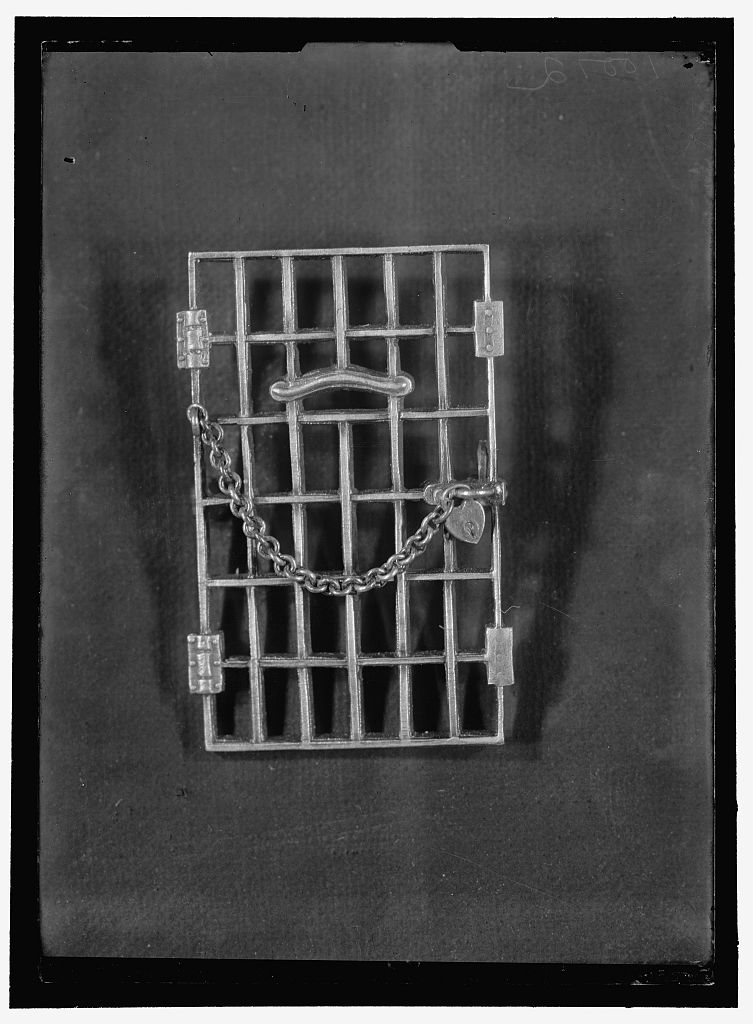 Rectangular jail cell door pin with a chain and heart