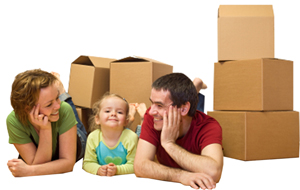 Happy Family with moving boxes