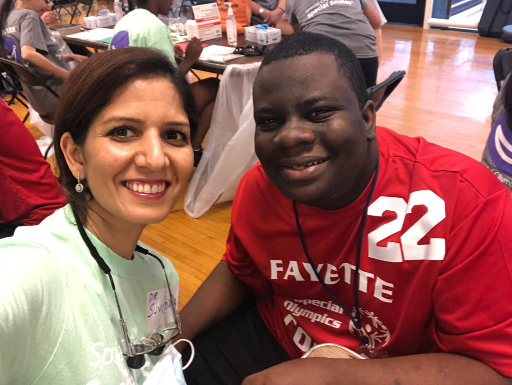 Cosmetic dentist in roswell ga - Suvidha Sachdeva volunteering at special olympics