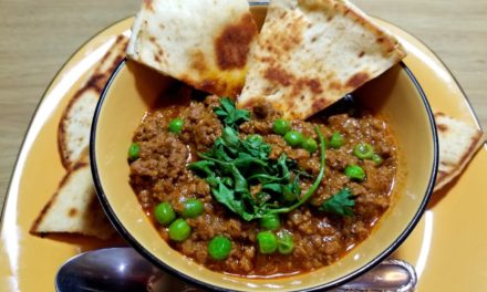 Indian beef curry with peas and buttery Naan