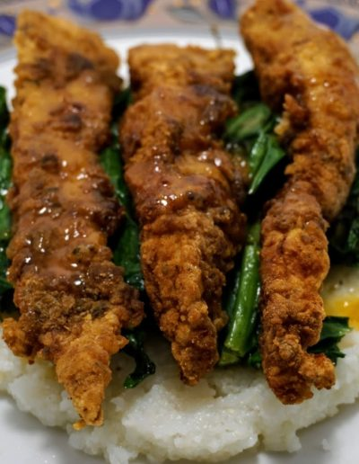Chicken Strips and grits