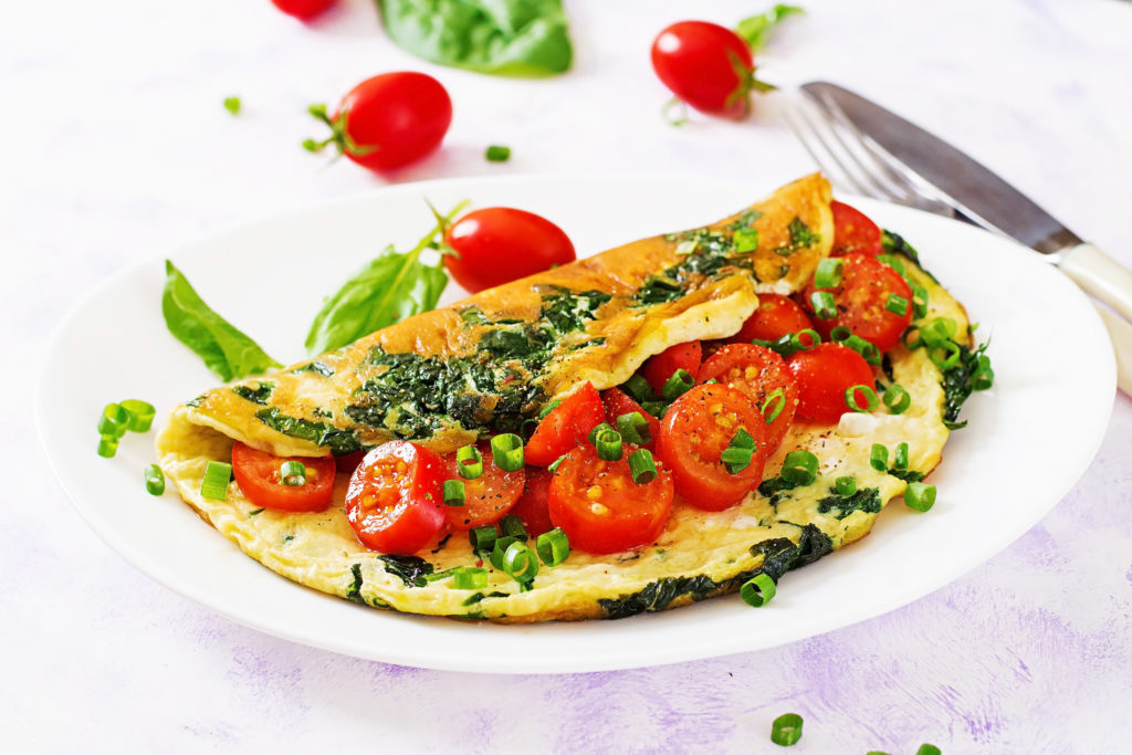 omelette-with-tomatoes-spinach-and-green-onion-on-ZLQ9AGP